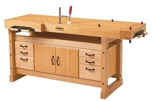 A woodworking workbench with both a front and an end vise.